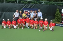 Singles Champion and Finalist with tournament directors and ball kids.