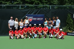 Doubles Champions and Finalists with tournament directors and ball kids.